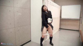 Japanese School Girl is masturbating while standing on the corridor.